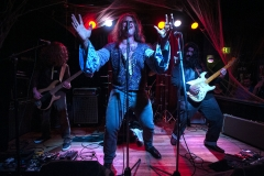 """Mind Vice performs as Black Sabbath during the 2015 """"Come as You Aren't"""" Battle of the Bands Halloween competition Oct. 31 at The Skylark in West Seattle. Band members include: Walter O'Toole, vocals, Michael Knapp, guitar, Ian """"liquid fingers"""" Sides, bass, and Miles Hubbard, drums."""