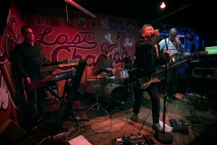 Young Pioneers performs at Slim's Last Chance Saloon in Seattle. Band members include Chris Pugh, guitar and vocals, Bradley J. Sweek, guitar, Nathan Paul, bass, Colm Meek, keyboards, and Scott Vanderpool, drums.