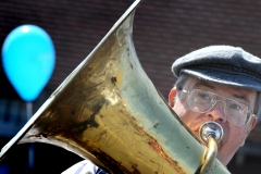 Tuba player Paul Ostler performs with fellow members of the Foggy Bottom Jazz Band May 19 during Armed Forces Day on JBLM.