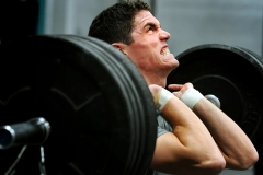 Brian O'Conner completes a set of front squats during a recent CrossFit workout at McVeigh Sports and Fitness Center.