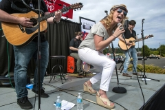 "Country singer Adley Stump, a former contestant on NBC's hit reality show ""The Voice,"" performs her song ""Stay at Home Soldier"" outside the Lewis Main Exchange June 24."