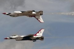 "Two members of the U.S. Air Force Thunderbirds air demonstration team perform the ""Calypso Pass"" high above McChord Field during the JBLM Airshow & Warrior Expo Saturday."