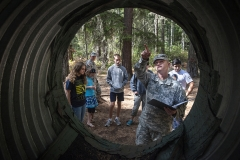"Instructor Staff Sgt. Mike Edwards, right, goes over the course rules for the ""Rat Hole"" obstacle Aug. 24 during an 84th CAB Community Connector event at the JBLM Field Reaction Leader Course on Lewis Main."