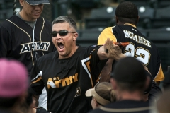 Army's Danny Rogers (middle) celebrates with teammates after hitting one of his two home runs against Navy May 21 during the 2nd annual Armed Forces Softball Classic at Cheney Stadium in Tacoma. Army defeated Navy 20-7 in the championship game.
