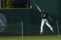 Army center fielder Jose Salas just misses saving a home run against Navy May 21 during the 2nd annual Armed Forces Softball Classic at Cheney Stadium in Tacoma. Army defeated Navy 20-7 in the championship game.