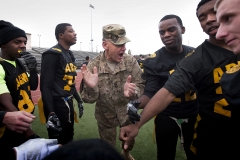 I Corps commander Lt. Gen. Stephen R. Lanza, middle, rallies Army players at halftime during the 17th annual Puget Sound Army vs. Navy Flag Football Classic at Cowan Stadium on Lewis Main Nov. 18. Navy defeated Army 28-0.