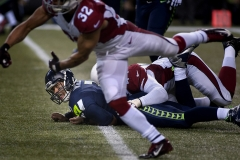 Seahawks quarterback Russell Wilson watches a pass fall incomplete after a near sack Nov. 15 during Seattle's 39-32 loss at CenturyLink Field in Seattle.