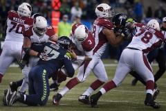 Seahawks defensive tackle Ahtyba Rubin (77) sacks Cardinals quarterback Carson Palmer Nov. 15 during Seattle's 39-32 loss at CenturyLink Field in Seattle.