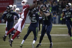 Cardinals receiver Jaron Brown, left, makes a juggling catch over Seahawks defenders Richard Sherman, middle, and Cassius Marsh Nov. 15 during Arizona's 39-32 win at CenturyLink Field in Seattle.