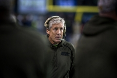 """Seahawks coach Pete Carroll uses a special military-themed headset Nov. 15 during the team's """"Salute to Service"""" game against the Arizona Cardinals at CenturyLink Field in Seattle."""