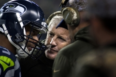 Seahawks coach Pete Carroll, middle, confers with quarterback Russell Wilson, left, and offensive coordinator Darrell Bevell Nov. 15 during Seattle's 39-32 loss to the Arizona Cardinals at CenturyLink Field in Seattle.