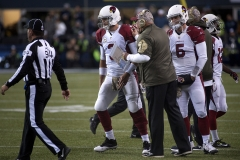 Cardinals quarterback Carson Palmer (3) confers with coach Bruce Arians along the sidelines Nov. 15 during Arizona's 39-32 win at CenturyLink Field in Seattle.