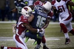 Cardinals safetys Tony Jefferson (22) and Deone Bucannon (20) combine to stop Seahawks receiver Tyler Lockett Nov. 15 during Arizona's 39-32 win at CenturyLink Field in Seattle.