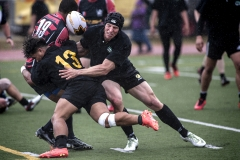Army's Ray Alainuuese (13) and Nate Conkey, right, combine to stop Navy's Kalaechi Young (19) during the 18th annual Pacific Northwest Army-Navy Rugby Championship Saturday, May 21 at Cowan Stadium on Lewis Main. Army defeated Navy 43-0 to win the Commander's Cup.