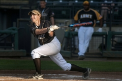 Army's April Ortenzo delivers a base hit to left field during the team's second round game against Special Forces May 20 during the 2nd annual Armed Forces Softball Classic at Cheney Stadium in Tacoma. Army defeated Navy 20-7 in the championship game.